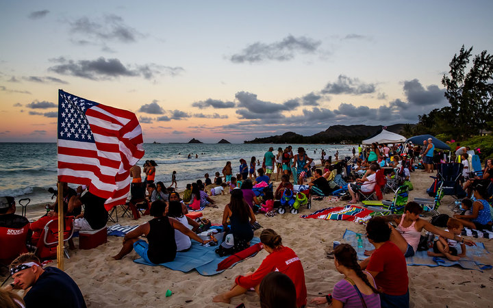 People on beach celebrating July 4th