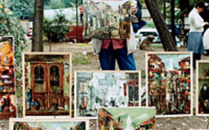 Martha Camarillo A painter sells his work outdoors.