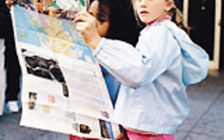 Luca Zorden Two girls consult a map in New York City.
