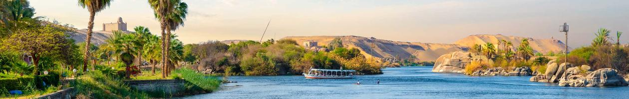 River Nile and boats at sunset in Aswan, Egypt