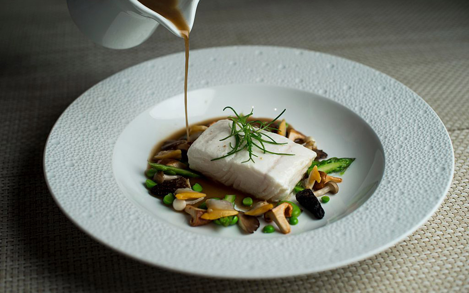 Poached Halibut with manila clams and chanterelle at Le Bernardin in Manhattan, New York