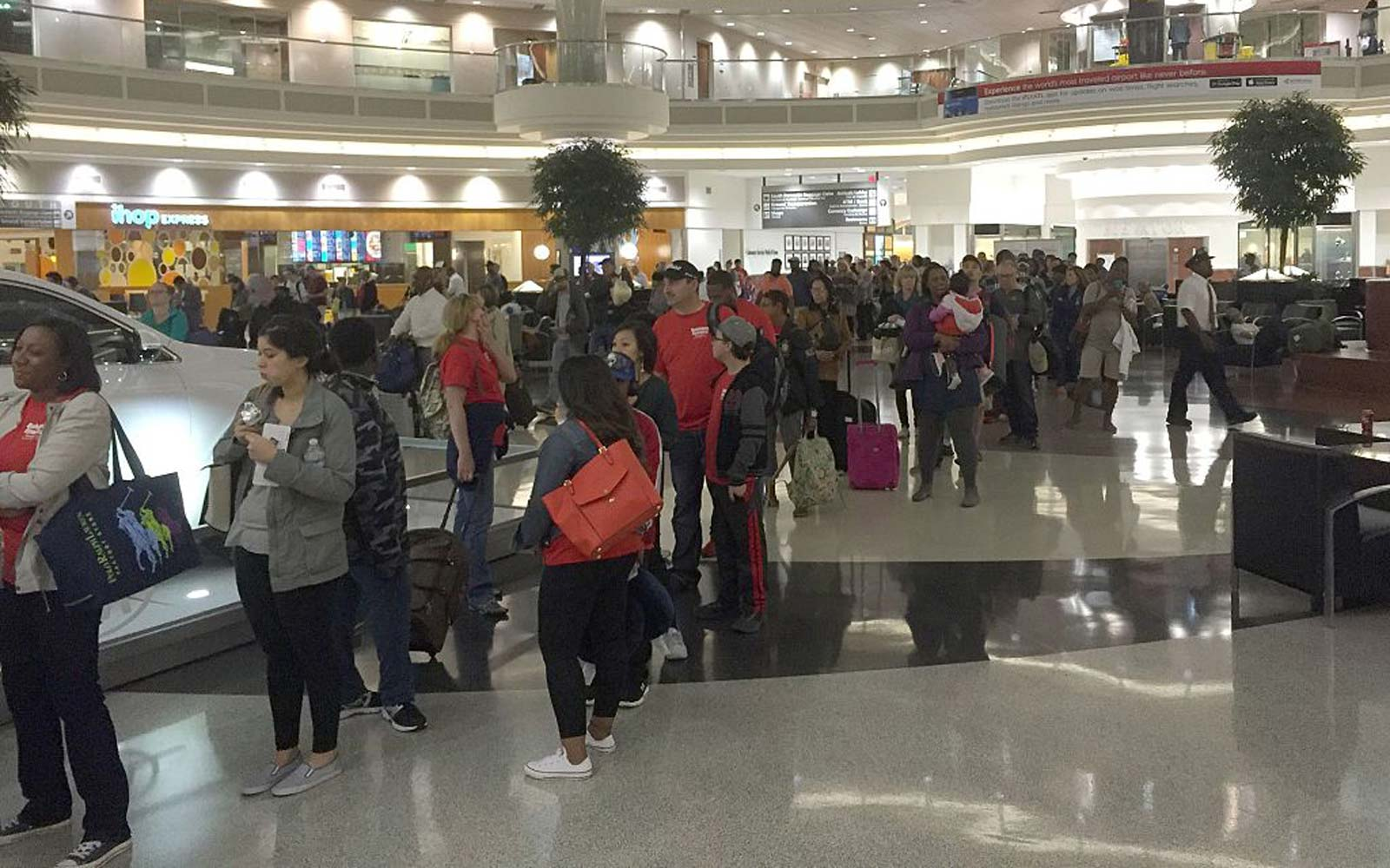 Passengers wait to go through security at the north terminal of the HartsfieldJackson Atlanta International Airport in Atlanta, Georgia
