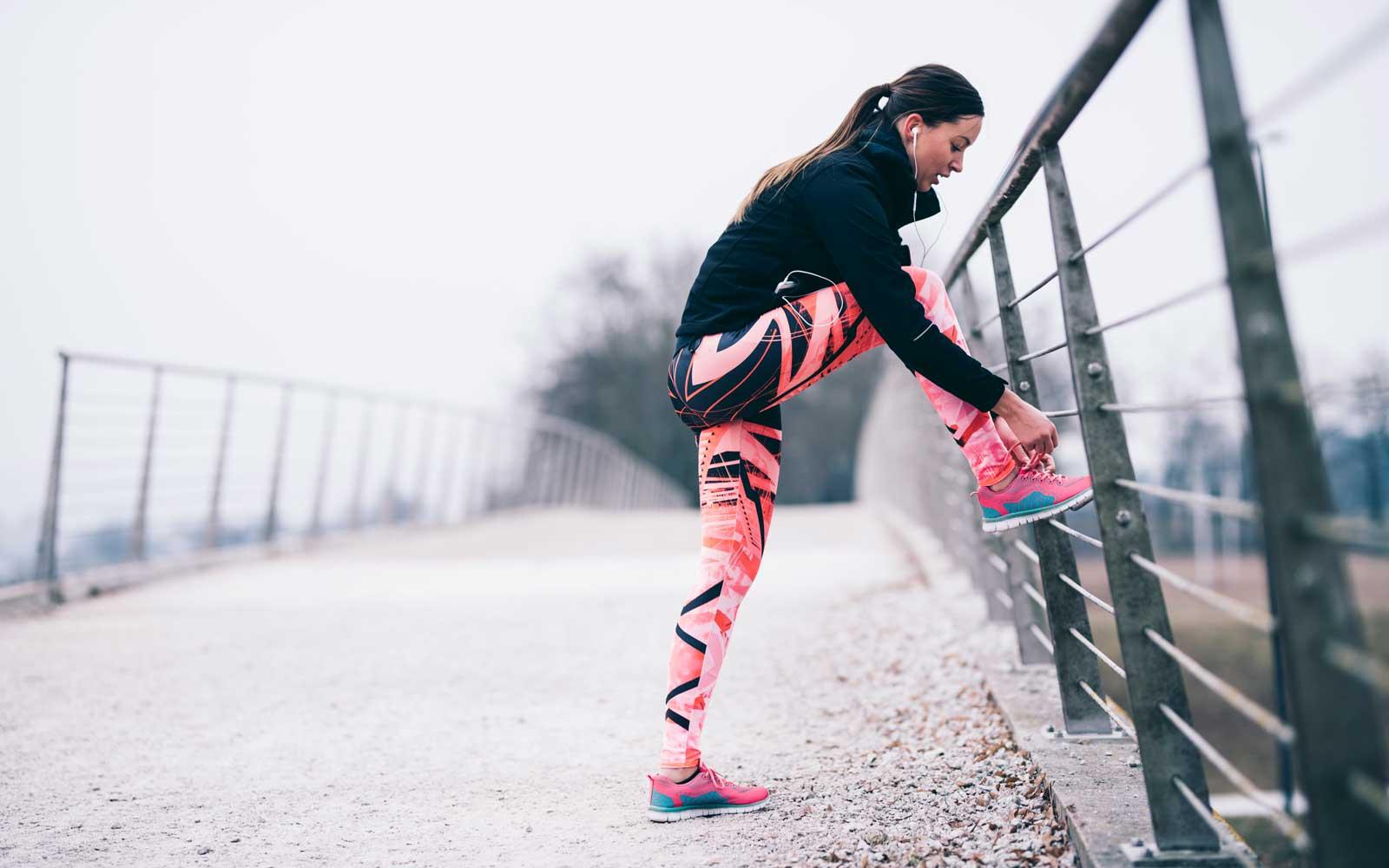 Woman preparing to go for a run in winter