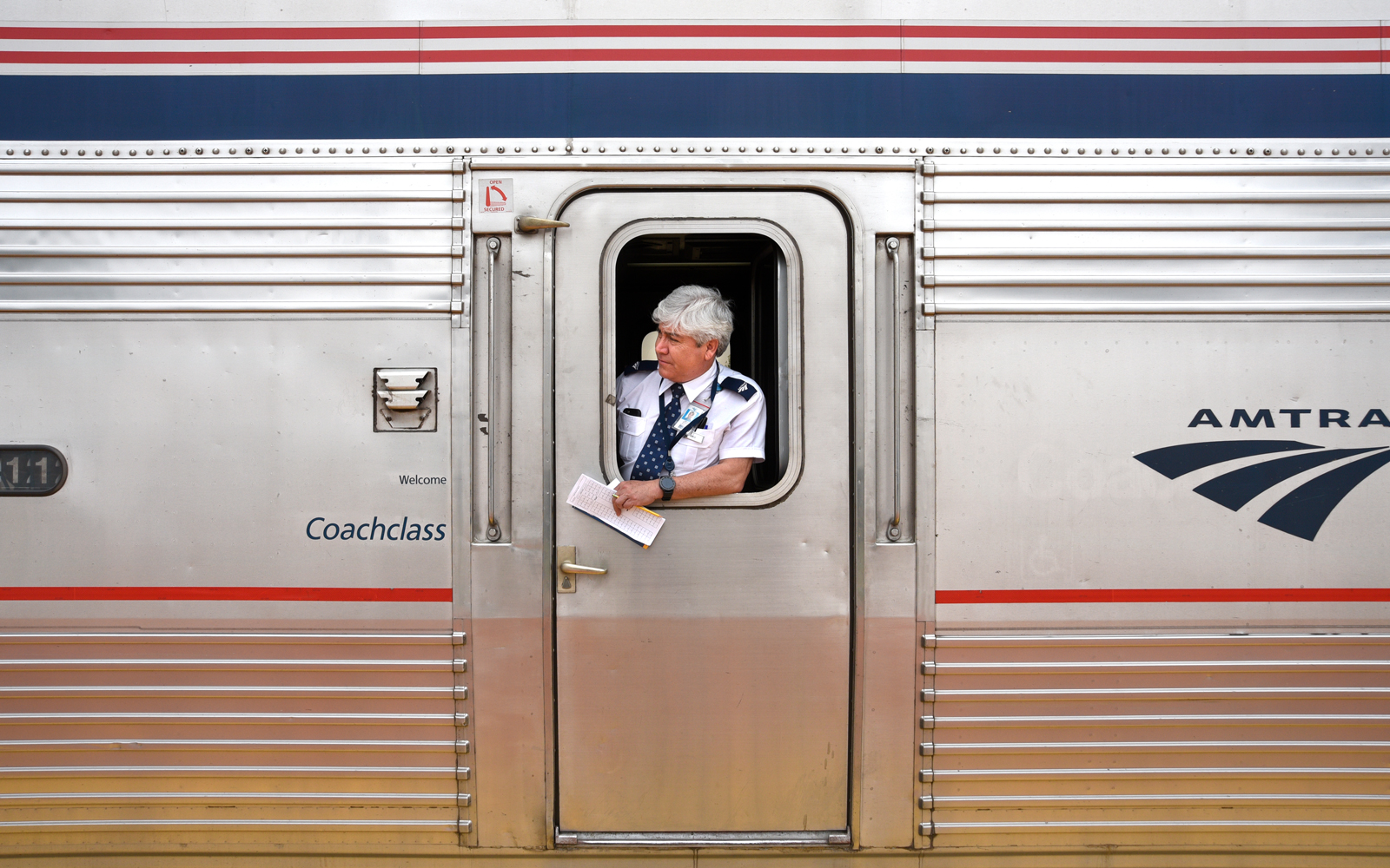 An assistant conductor on an Amtrak train