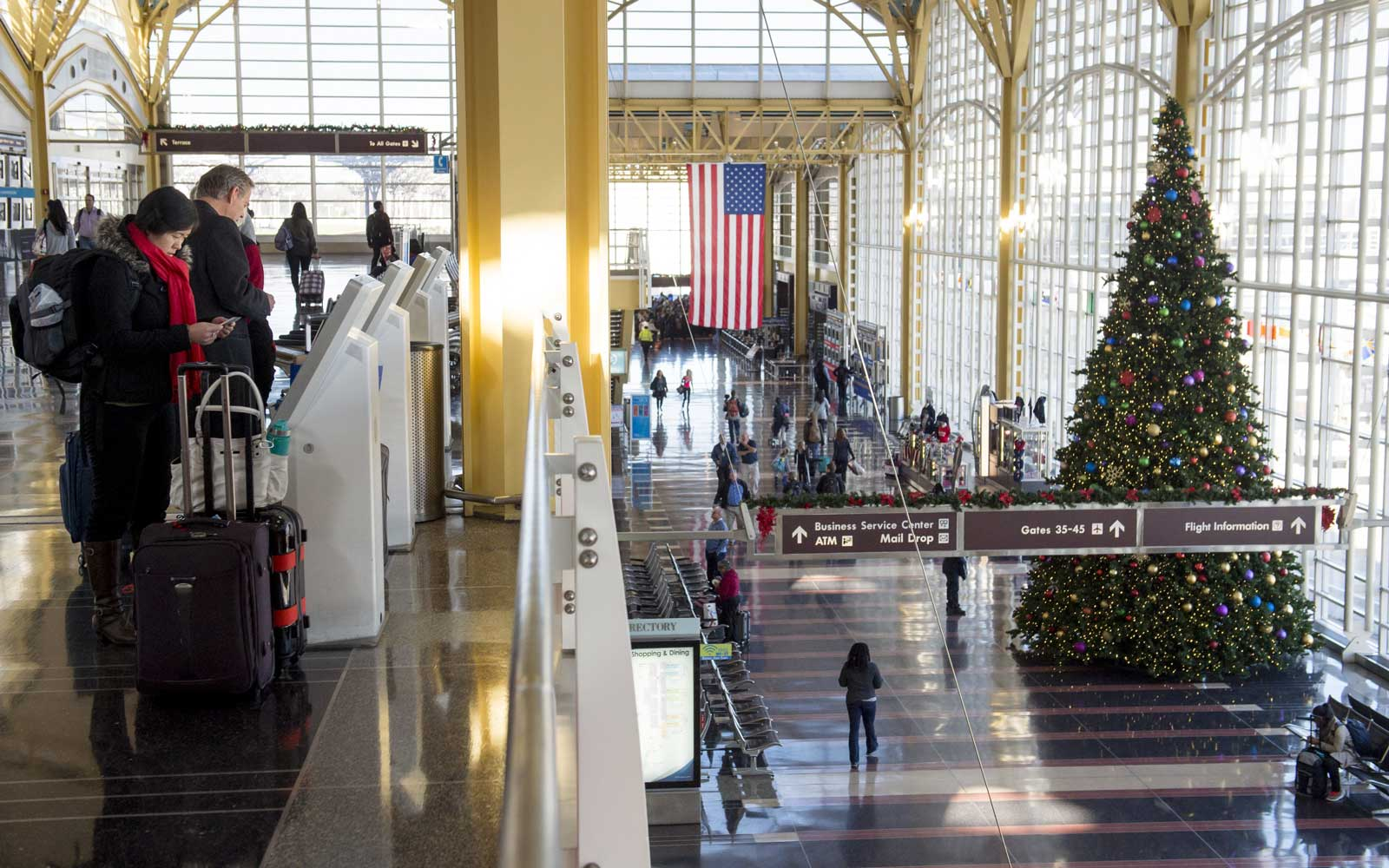 Travelers check-in for flights in the airport terminal at Ronald Reagan Washington National Airport