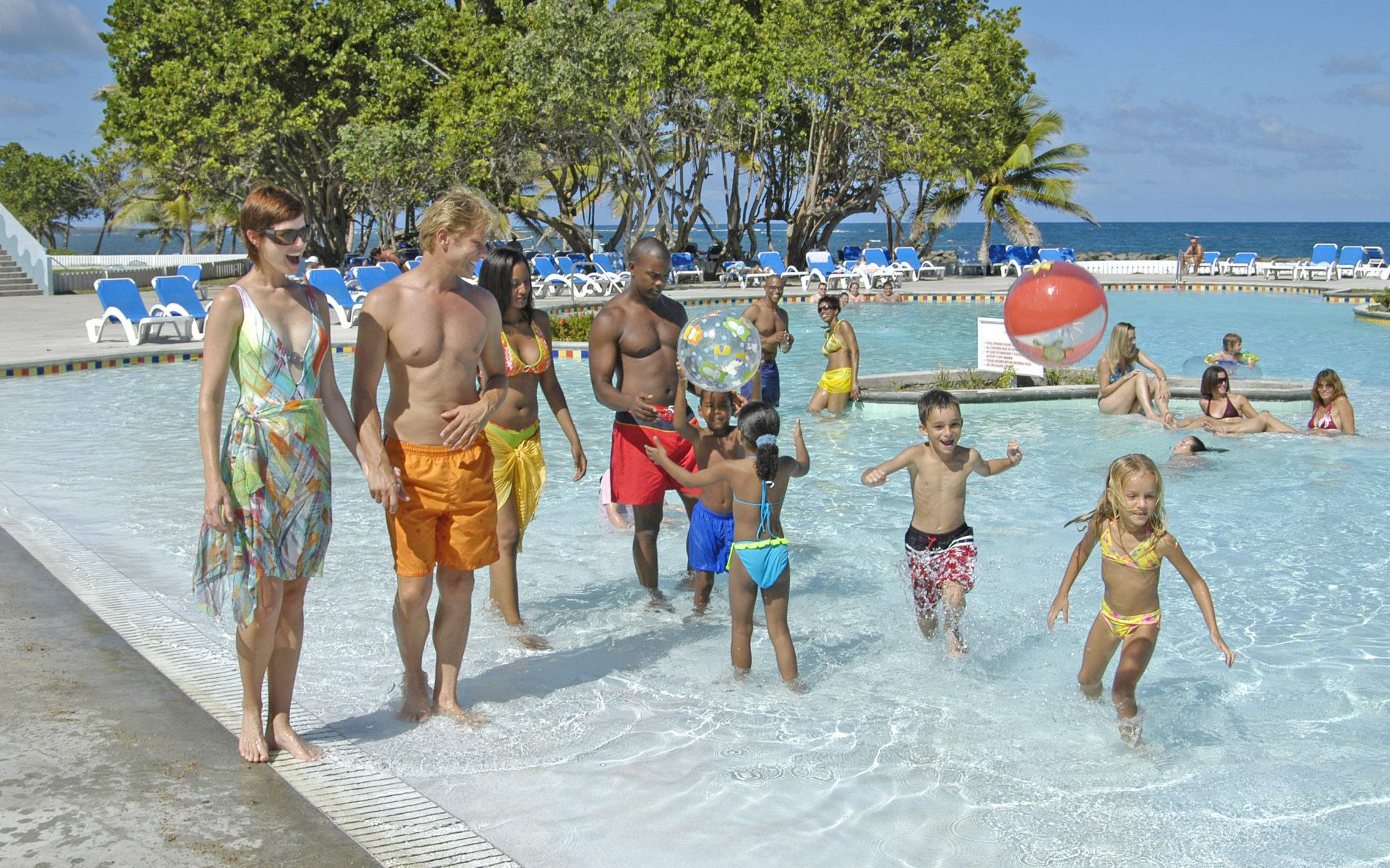 Family in pool at Coconut Bay Beach Resort & Spa, St. Lucia