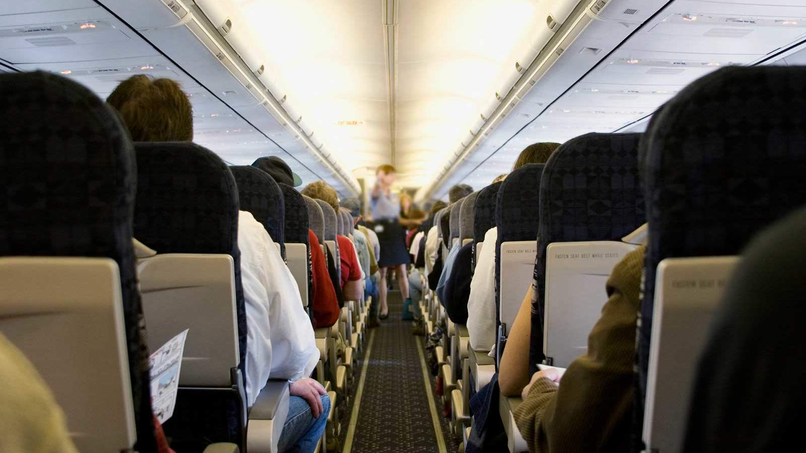 Passengers from airplane aisle