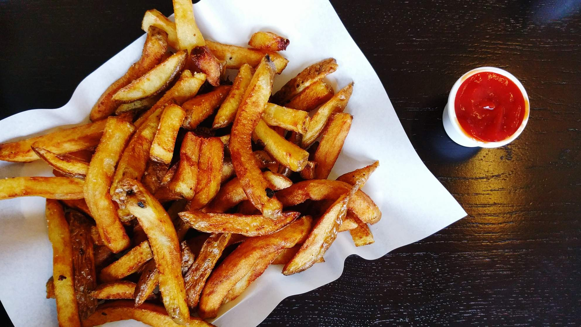 French fries and ketchup on a table