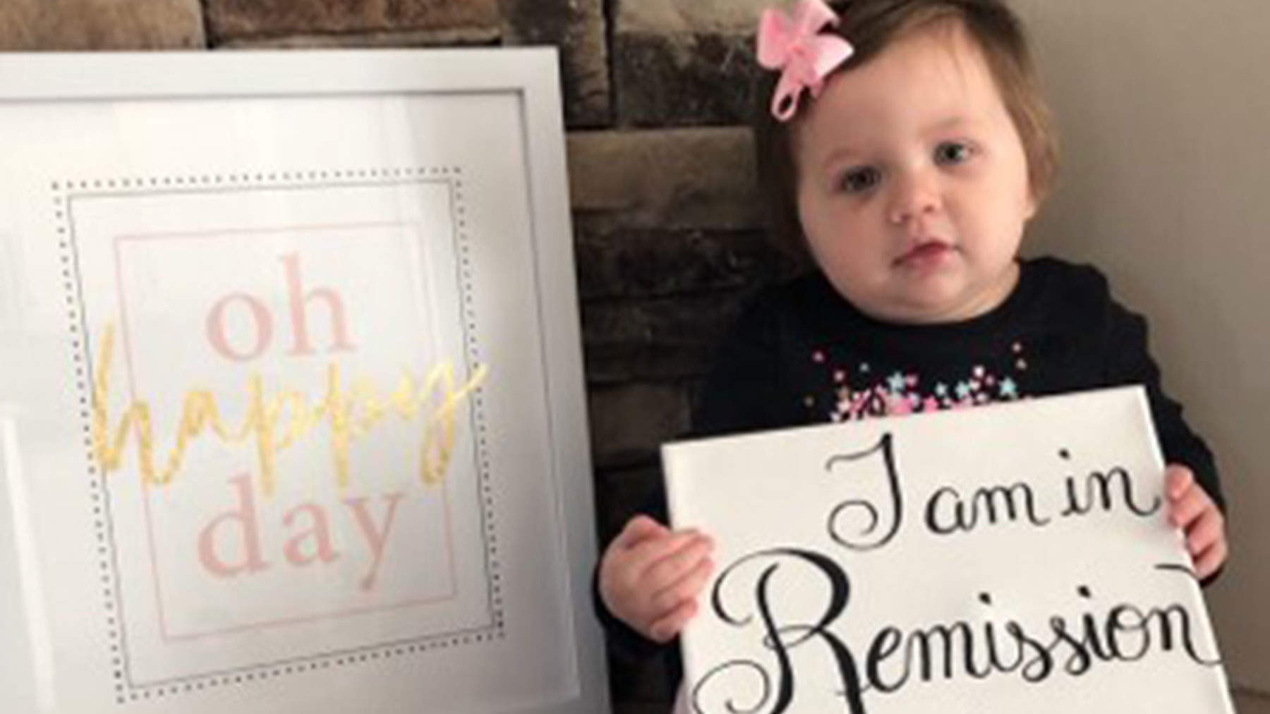 1-Year-Old Girl Who Beat Stage 4 Cancer Poses for Sweet Photos Announcing the News