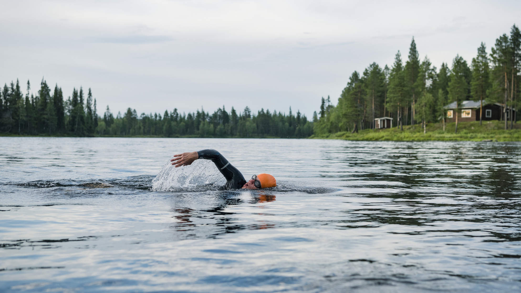 Person swimming in lake