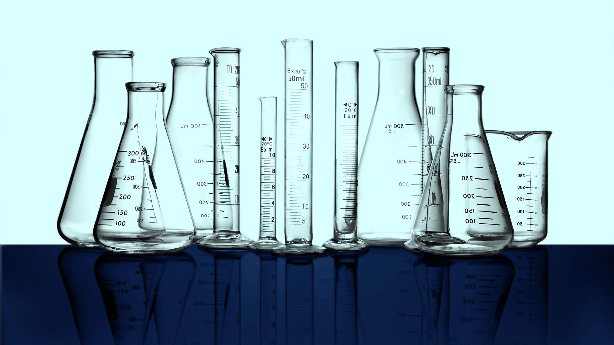 science_test tubes_beakers_light green background TIME health stock