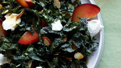 tuscan-kale-with-almonds-plums-and-goat-cheese
