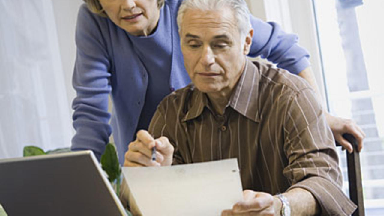 couple-viewing-paperwork