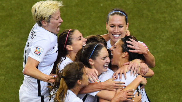 USA's midfielder and goal scorer Carli Lloyd (R) celebrates with teammates during their 2015 FIFA Women's World Cup semifinal match against Germany at Olympic Stadium in Montreal on June 30, 2015.