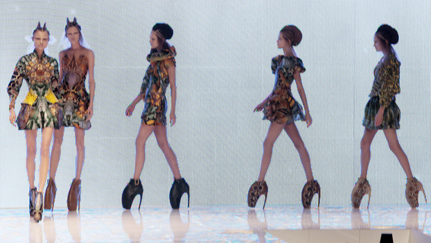 Models present outfits by British deigne