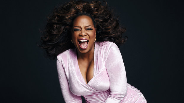 Oprah Winfrey wearing a pink dress for the InStyle March cover story shoot