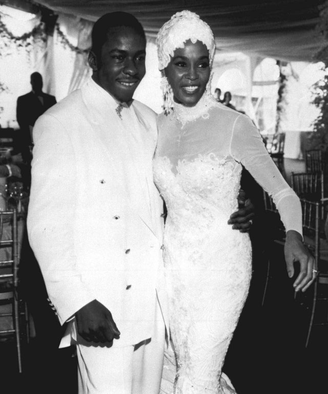 Singer Whitney Houston, right, is seen with her husband Bobby Brown during their wedding, in this 1992 photo. (AP Photo)