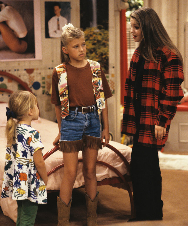 UNITED STATES - DECEMBER 01:  FULL HOUSE -  I'm Not D.J.  - Season Six - 12/1/92, Michelle (Mary Kate/Ashley Olsen, left) and D.J. (Candace Cameron, right) helped Stephanie (Jodie Sweetin) after her ears became infected from Kimmy's piercing.