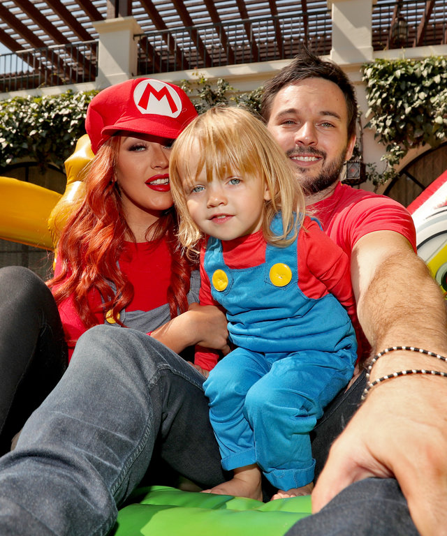 BEVERLY HILLS, CA - AUGUST 20:  (NO TABLOIDS; NO BAUER MEDIA) (L-R) Singer Christina Aguilera, daughter Summer Rain Rutler and Matthew Rutler pose in the bouncy house during the second birthday party for Christina Aguilera's daughter Summer Rain Rutler at
