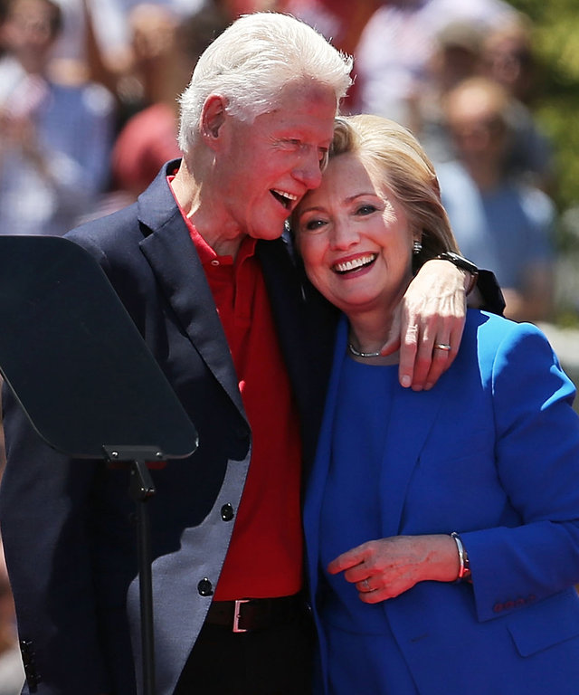 NEW YORK, NY - JUNE 13:  People cheer after Democratic Presidential candidate Hillary Clinton stands on stage with her husband former president Bill Clinton after her official kickoff rally at the Four Freedoms Park on Roosevelt Island in Manhattan