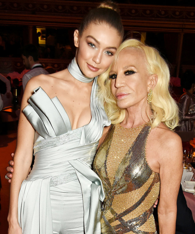 LONDON, ENGLAND - DECEMBER 05:  Gigi Hadid (L) and Donatella Versace attend The Fashion Awards 2016 drinks reception at Royal Albert Hall on December 5, 2016 in London, United Kingdom.  (Photo by David M. Benett/Dave Benett/Getty Images)
