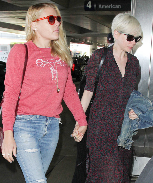 LOS ANGELES, CA - JANUARY 30: Michelle Williams and Busy Philipps are seen at LAX on January 30, 2017 in Los Angeles, California.  (Photo by starzfly/Bauer-Griffin/GC Images)