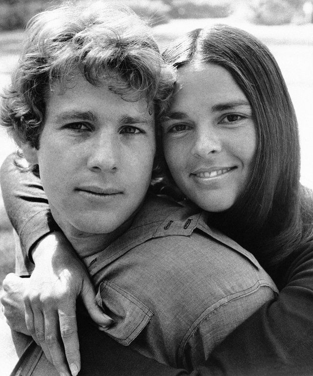 Ali McGraw embraces Ryan O'Neal in a scenes from the film  Love Story  1970.