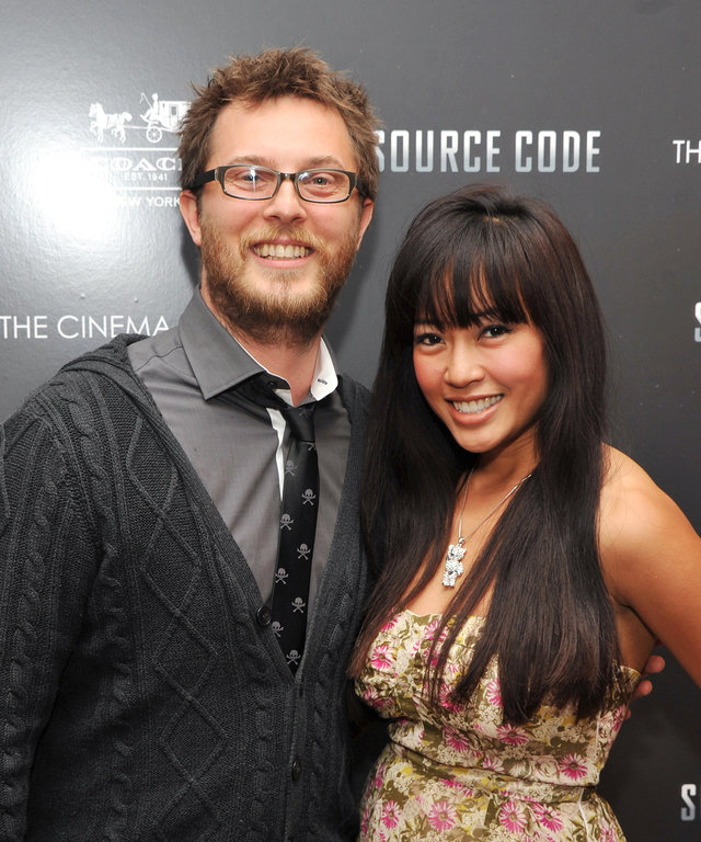Director Duncan Jones and Rodene Ronquillo attend the Cinema Society & Coach screeing of 'Source Code' at the Crosby Street Hotel on March 31, 2011 in New York City.