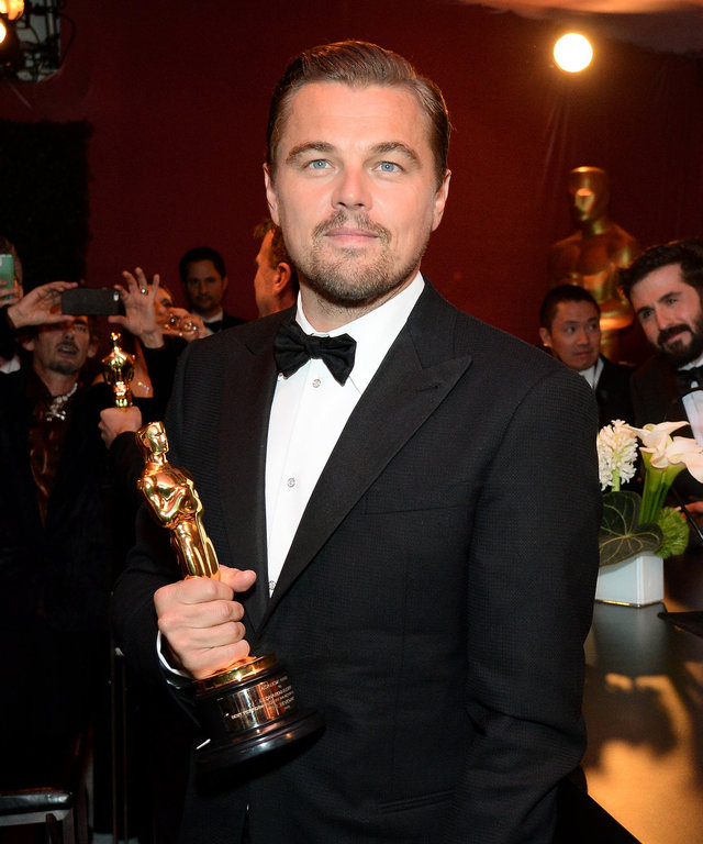 Actor Leonardo DiCaprio, winner of the Best Actor award for 'The Revenant,' poses with his Oscar at the 88th Annual Academy Awards Governors Ball at Hollywood & Highland Center in Hollywood, California, on February 28, 2016.