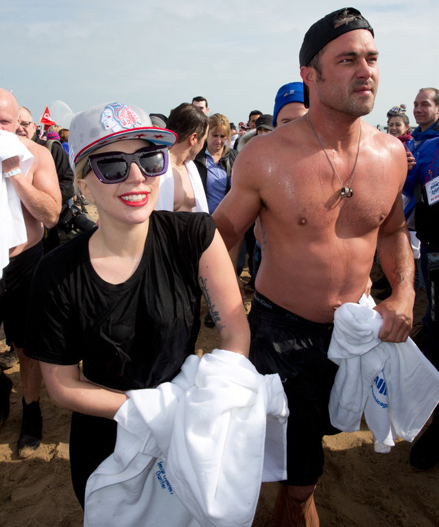 Lady Gaga and Taylor Kinney take part in the 16th Annual Polar Plunge at North Avenue Beach on March 6, 2016 in Chicago, Illinois.