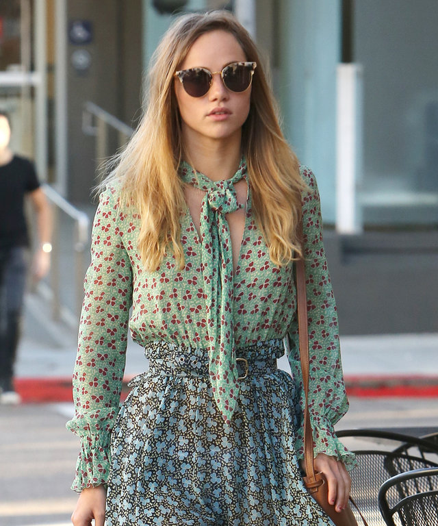 Suki Waterhouse seen in a clover pattern dress on St Patrick's Day as she stops by the Urth Caffe for lunch in Beverly Hills