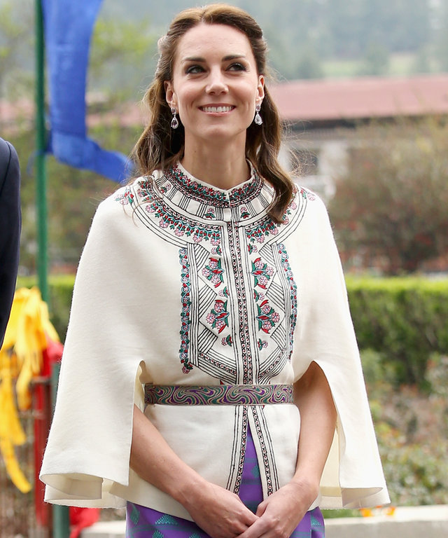 Catherine, Duchess of Cambridge walks with Prince William, Duke of Cambridge as part of a ceremonial Chipdrel on arrival into the Tashichhodzong (fortress) on the first day of a two day visit to Bhutan on the 14th April 2016 in Paro, Bhutan. The Royal cou