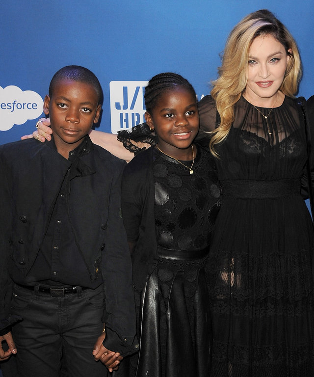 BEVERLY HILLS, CA - JANUARY 09:  (L-R) David Banda, Mercy James, musician Madonna and host Sean Penn attend the 5th Annual Sean Penn & Friends HELP HAITI HOME Gala benefiting J/P Haitian Relief Organization  at Montage Hotel on January 9, 2016