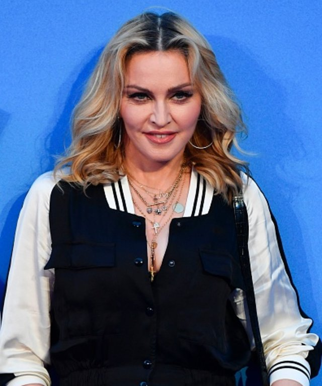 US singer-songwriter Madonna poses arriving on the carpet to attend a special screening of the film  The Beatles Eight Days A Week: The Touring Years  in London on September 15, 2016. / AFP PHOTO / Ben STANSALL        (Photo credit should read BEN...