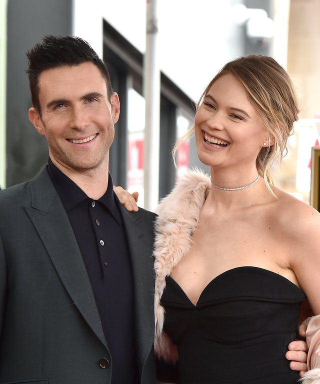 HOLLYWOOD, CA - FEBRUARY 10:  Recording artist Adam Levine and wife model Behati Prinsloo attend the ceremony honoring Adam Levine with star on the Hollywood Walk of Fame on February 10, 2017 in Hollywood, California.  (Photo by Axelle/Bauer-Griffin...