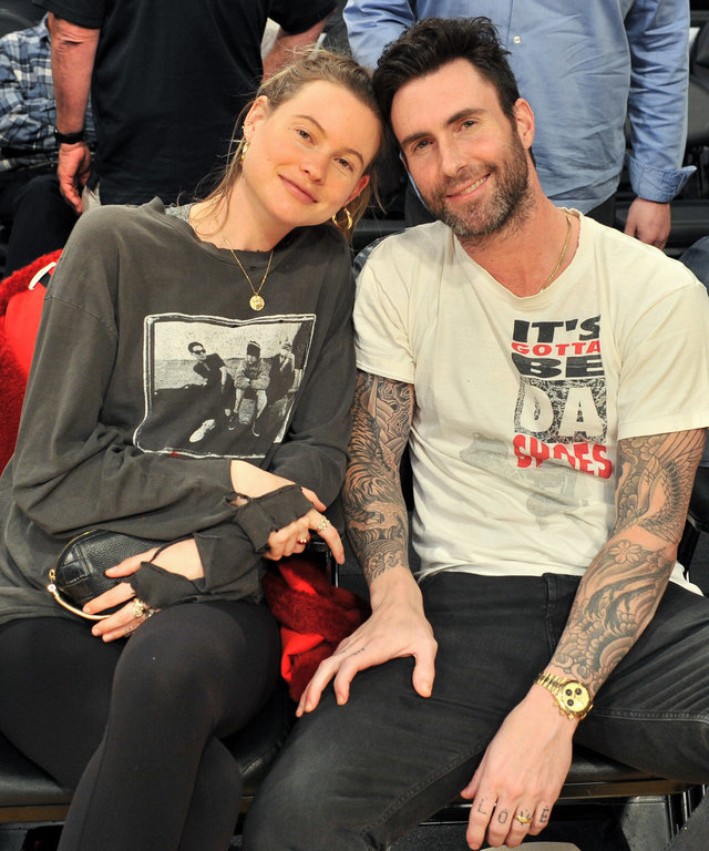 LOS ANGELES, CA - DECEMBER 03:  Singer Adam Levine and model Behati Prinsloo attend a basketball game between the Los Angeles Lakers and the Houston Rockets at Staples Center on December 3, 2017 in Los Angeles, California.  (Photo by Allen Berezovsky...