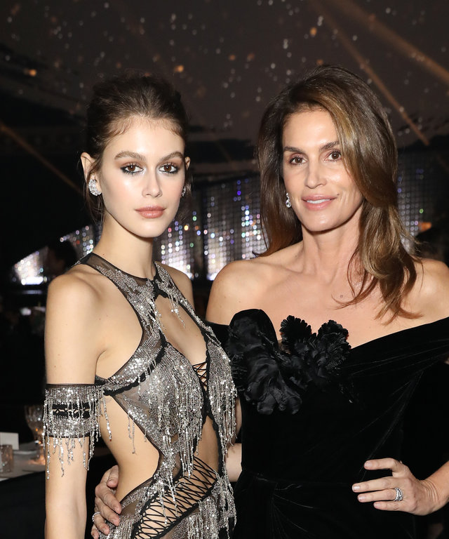 LONDON, ENGLAND - DECEMBER 10: Kaia Gerber (L) and Cindy Crawford during pre-ceremony drinks at The Fashion Awards 2018 In Partnership With Swarovski at Royal Albert Hall on December 10, 2018 in London, England. (Photo by Darren Gerrish/BFC/Getty Images)