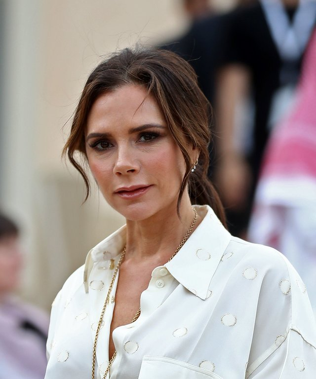British singer and fashion designer Victoria Beckham attends the official opening ceremony for the National Museum of Qatar, in the capital Doha on March 27, 2019. - The complex architectural form of a desert rose, found in Qatars arid desert regions,...