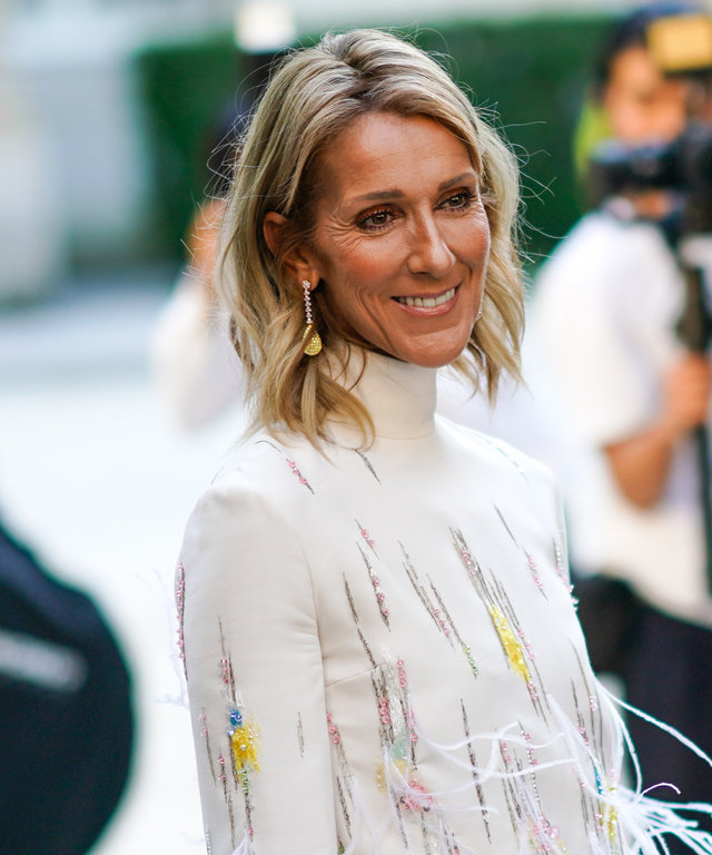 PARIS, FRANCE - JULY 03: Celine Dion wears a white fluffy dress with turtleneck, outside Valentino, during Paris Fashion Week -Haute Couture Fall/Winter 2019/2020, on July 03, 2019 in Paris, France. (Photo by Edward Berthelot/Getty Images)