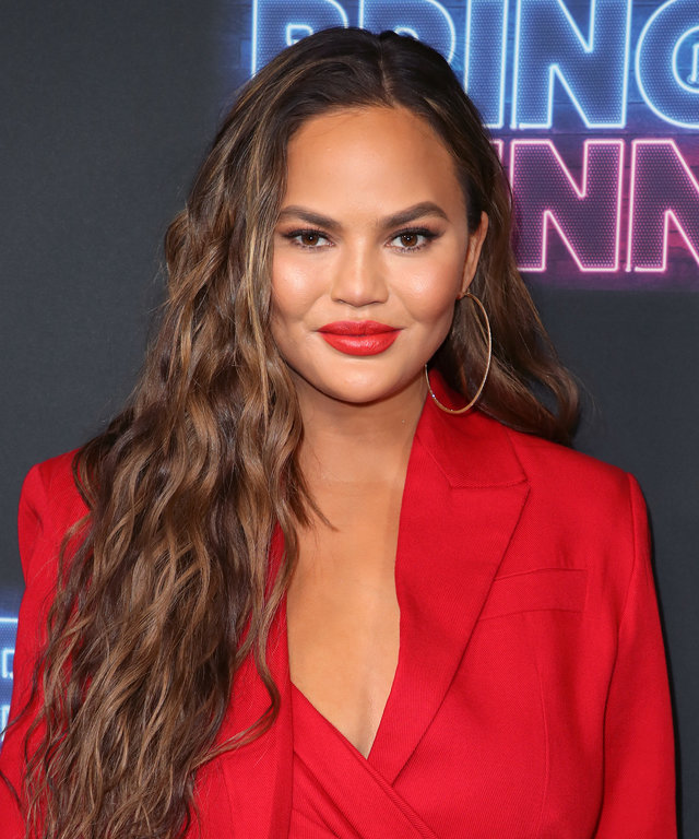 LOS ANGELES, CALIFORNIA - JUNE 26: Chrissy Teigen attends the premiere of NBC's  Bring The Funny  at Rockwell Table & Stage on June 26, 2019 in Los Angeles, California. (Photo by David Livingston/Getty Images)