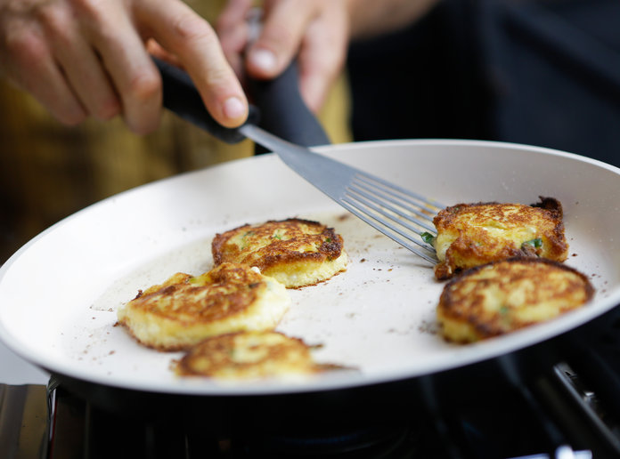 CORN-BASIL FRITTERS WITH SCALLION CREAM
