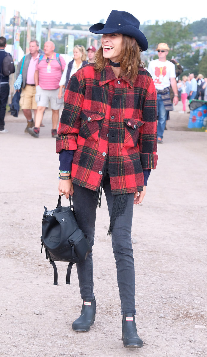 Alexa Chung lassoes a western look together for Glastonbury with Hunter Originals backpack and boots.