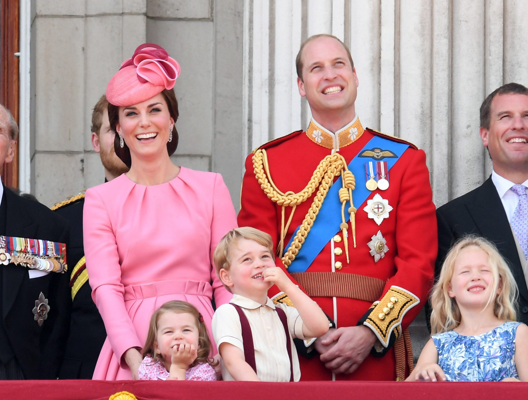 The family laughs at the annual Trooping the Colour