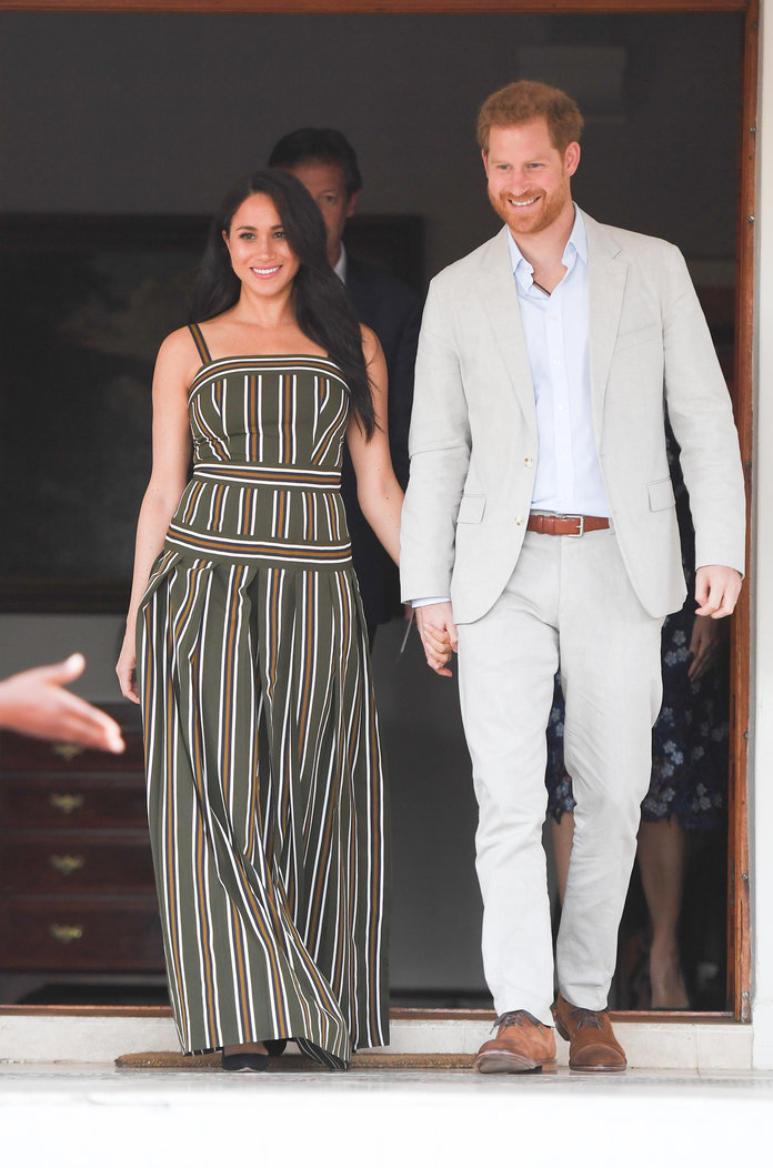 Megan Markle wearing a striped dress during her trip to Africa