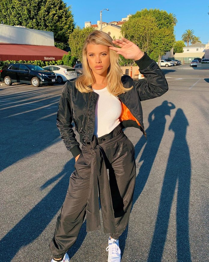 Sofia Richie wearing a black tracksuit