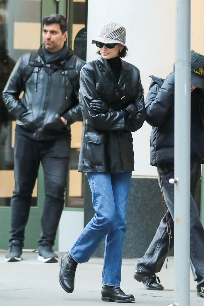 Kaia Gerber wearing a coat and a bucket hat