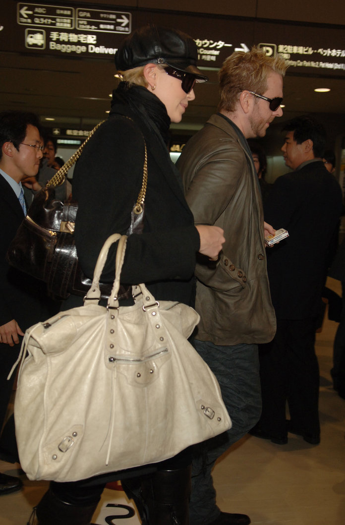 Charlize Theron at the airport in 2006