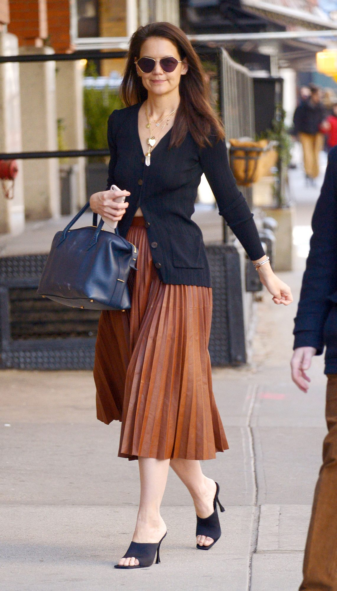 katie Holmes always wear this skirt trend