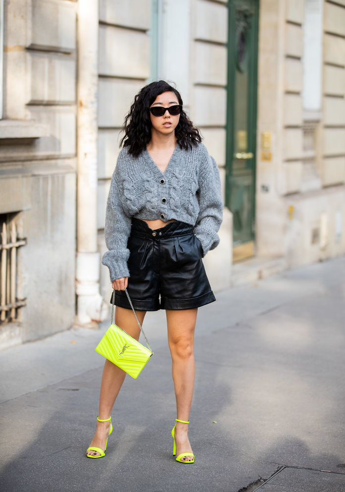 leather shorts fashion trend 2020, leather shorts and a cardigan sweater outfit idea
