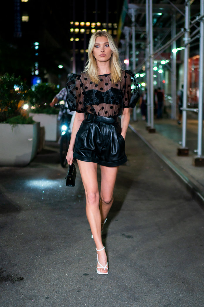 leather shorts fashion trend 2020, elsa hosk wearing leather shorts and a sheer top